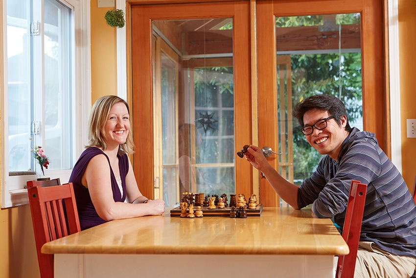 The Suzuki family playing chess in their energy-efficient home