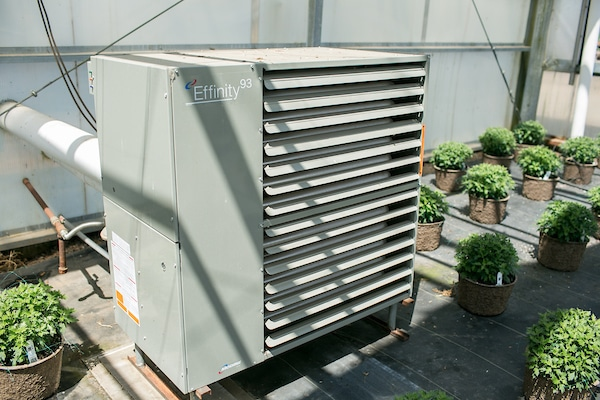 a condensing unit outside of a greenhouse